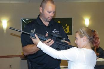 Explaining how to handle the modern sporting rifle.